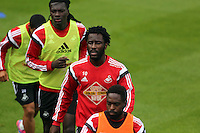 Pictured BACK to FRONT: Bafetimbi Gomis, Wilfried Bony and Nathan Dyer. Thursday 14 August 2014<br /> Re: Swansea City FC training at Fairwood, south Wales, ahead of their first game of the Premier League season against Manchester United this coming Saturday.