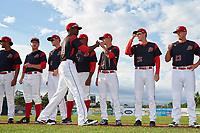 Batavia Muckdogs outfielder Thomas Jones (49) fist bumps Shane Sawczak (21), Hunter Wells (35), and Brent Wheatley (23) during introductions before a game against the Auburn Doubledays on June 19, 2017 at Dwyer Stadium in Batavia, New York.  Also shown (L-R) is Jeremy Ovalle, RJ Peace, Remey Reed (32), and Manuel Rodriguez.  Batavia defeated Auburn 8-2 in both teams opening game of the season.  (Mike Janes/Four Seam Images)