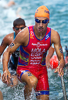 29 JUN 2014 - CHICAGO, USA - Mario Mola (ESP) of Spain leaves the water at the end of the first swim lap during the elite men's ITU 2014 World Triathlon Series round in Grant Park, Chicago in the USA (PHOTO COPYRIGHT © 2014 NIGEL FARROW, ALL RIGHTS RESERVED)