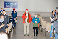 People wearing Donald Trump campaign clothing say the Pledge of Allegiance before Donald Trump, Jr., the son of US president Donald Trump, speaks at a 'Make America Great Again!' campaign rally at DoubleTree by Hilton MHT in Manchester, New Hampshire, on Thu., Oct. 29, 2020. The event took place five days before the Nov. 3 presidential election.