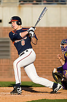 John Hicks #8 of the Virginia Cavaliers follows through on his swing versus the East Carolina Pirates at Clark-LeClair Stadium on February 19, 2010 in Greenville, North Carolina.   Photo by Brian Westerholt / Four Seam Images