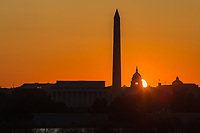 The sun rises behind the US Capitol Building near the spring equinox in Washington DC.