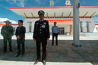 A train attendant in Damxung train station, last stop before Lhasa, Tibet..19 Jul 2006