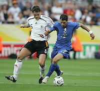 Sebastian Kehl, Simone Perrotta.  Italy defeated Germany, 2-0, in overtime in their FIFA World Cup semifinal match at FIFA World Cup Stadium in Dortmund, Germany, July 4, 2006.