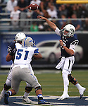 Nevada quarterback Cody Fajardo passes during the first half of an NCAA football game against Air Force in Reno, Nev., on Saturday, Sept. 28, 2013.<br /> Photo by Cathleen Allison