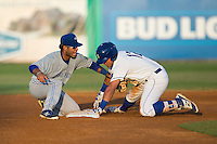 Gabriel Cancel (12) of the Burlington Royals avoids the tag attempt by Juandy Mendoza (10) of the Bluefield Blue Jays as he reaches for second base at Burlington Athletic Stadium on June 28, 2016 in Burlington, North Carolina.  The Royals defeated the Blue Jays 4-0.  (Brian Westerholt/Four Seam Images)