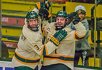 29 December 2013:  University of Vermont Catamount Forward Jake Fallon (right), a Junior from Southlake, Texas, celebrates with Chris McCarthy (left) after scoring the tournament-winning goal in the final game against the Canisius College Golden Griffins at Gutterson Fieldhouse in Burlington, Vermont. The Catamounts defeated the Golden Griffins 6-2 to capture the 2013 Sheraton/TD Bank Catamount Cup NCAA Hockey Tournament for the second straight year. Mandatory Credit: Ed Wolfstein Photo *** RAW (NEF) Image File Available ***