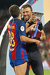 FC Barcelona's Jordi Alba (l) and the coach Luis Enrique Martinez celebrate the victory in theSupercup of Spain.August 17,2016. (ALTERPHOTOS/Acero)