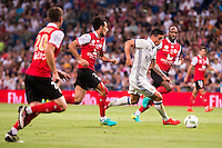 Real Madrid's player James Rodriguez and Stade de Reims's player Bouhours and Da Cruz during the XXXVII Santiago Bernabeu Trophy in Madrid. August 16, Spain. 2016. (ALTERPHOTOS/BorjaB.Hojas) /NORTEPHOTO