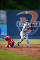 Mahoning Valley Scrappers second baseman Alexis Pantoja (12) turns a double play as Andres Martinez (32) slides into second during a game against the Auburn Doubledays on June 19, 2016 at Falcon Park in Auburn, New York.  Mahoning Valley defeated Auburn 14-3.  (Mike Janes/Four Seam Images)