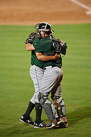 Daytona Tortugas relief pitcher Ryan Hendrix (21) hugs catcher Tyler Stephenson (30) after the final out of a game against the St. Lucie Mets on August 3, 2018 at First Data Field in Port St. Lucie, Florida.  Daytona defeated St. Lucie 3-2.  (Mike Janes/Four Seam Images)