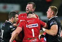 David Bulbring of the Scarlets (TOP) celebrates his team's win with team mate Wyn Jones during the Guinness PRO14 Round 6 match between Ospreys and Scarlets at The Liberty Stadium , Swansea, Wales, UK. Saturday 07 October 2017