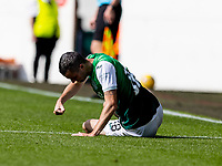 28th August 2021;  Easter Road , Leith, Edinburg, Scotland; Scottish Premier League football, Hibernian versus Livingston; Jamie Murphy of Hibernian punches the ground in frustration after an injury