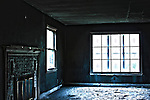 HDR image of a living room inside a house with fire smoke and water damage