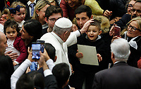 Pope Francis greets a child as he arrives to attend his weekly general audience in the Paul VI hall at the Vatican, January 22, 2020.<br /> <br /> UPDATE IMAGES PRESS/Riccardo De Luca<br /> <br /> STRICTLY ONLY FOR EDITORIAL USE