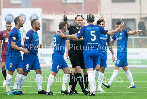 Montrose v St Johnstone…21.07.18…  Links Park    League Cup<br />Referee Barry Cook has words with Michael Bolochoweckyj<br />Picture by Graeme Hart. <br />Copyright Perthshire Picture Agency<br />Tel: 01738 623350  Mobile: 07990 594431