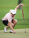 CHON BURI, THAILAND - FEBRUARY 16:  Kristy McPherson of USA lines up a putt on the 14th green during day one of the LPGA Thailand at Siam Country Club on February 16, 2012 in Chon Buri, Thailand.  Photo by Victor Fraile / The Power of Sport Images