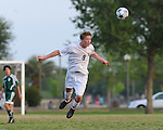 A Lafreniere soccer player appears to be caught in mid air after heading the ball.