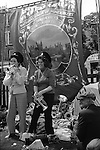 Mrs Rita Jobling and Mrs Bella Winnard, two coal miners wives, who lived in Kibblesworth are having fun and playing on the colliery silver bands musical instruments under the National Union of Mineworkers, Durham area Kibblesworth Lodge banner at the annual Durham Miners Gala. County Durham, England 1974. (Names thanks to Tom Winnard)