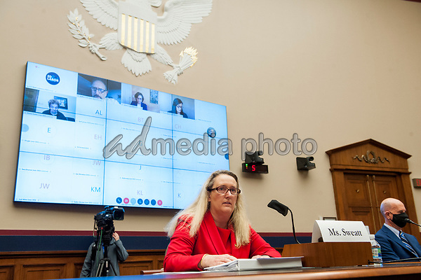 """Loren Sweatt Principal Deputy Assistant Secretary, Occupational Safety and Health Administration, Washington, D.C. (left) offers her opening remarks as John Howard MD, MPH,JD, LLM, MBA, Director, National Institute for Occupational Safety and Health, Washington, D.C. (right) listens, as they testify before a United States House Committee on Education and Labor Subcommittee on Workforce Protections Hearing: """"Examining the Federal Governments Actions to Protect Workers from COVID-19"""" in the Rayburn House Office Building on Capitol Hill in Washington, D.C., on Capitol Hill in Washington, DC, Thursday, May 28, 2020. <br /> Credit: Rod Lamkey / Pool via CNP/AdMedia"""