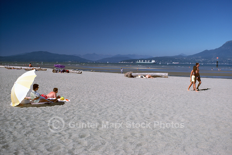 Vancouver, BC, British Columbia, Canada - Sunbathing on Beach at Spanish Banks - English Bay, Howe Sound, and Coast Mountains, Summer