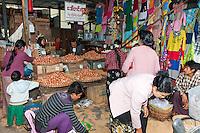 Myanmar, Burma.  Mandalay Market, Stall Selling Eggs and Clothing.