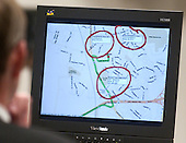 A map program is displayed on a screen during the trial of sniper suspect John Allen Muhammad in courtroom 10 at the Virginia Beach Circuit Court in Virginia Beach, Virginia on November 5, 2003.  The map program was found in the laptop found in the Chevrolet Caprice that Muhammad was arrested in. The circled areas represent shooting sites. <br /> Credit: Dave Ellis - Pool via CNP