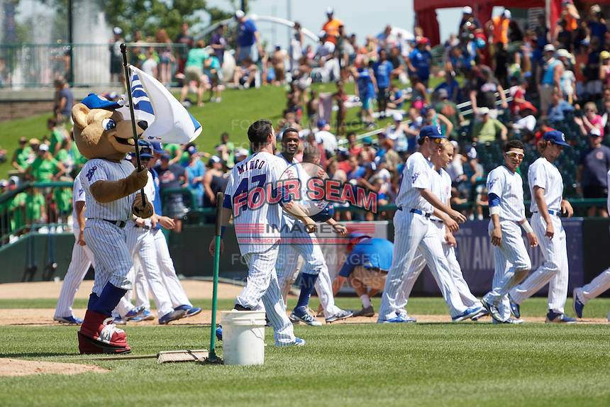 South Bend Cubs Alberto Mineo (47) walks off the field after giving the W flag back to mascot Stu after a game winning base hit during the first game of a doubleheader against the Peoria Chiefs on July 25, 2016 at Four Winds Field in South Bend, Indiana.  South Bend defeated Peoria 9-8.  (Mike Janes/Four Seam Images)