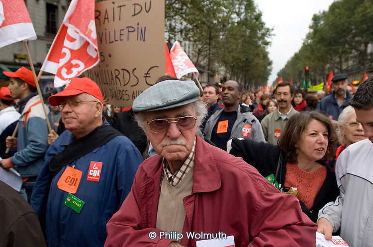 Mass demonstration in Paris against a new work contract, introduced by Prime Minister Dominique de Villepin, that allows companies with fewer than 20 employees to fire them within two years instead of six months.