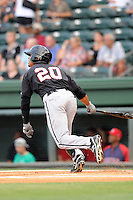 Center fielder Jacob May (20) of the Kannapolis Intimidators hits in a game against the Greenville Drive on Monday, August 5, 2013, at Fluor Field at the West End in Greenville, South Carolina. May was a third-round pick by the Chicago White Sox in the 2013 First-Year Player Draft. Kannapolis won, 3-0. (Tom Priddy/Four Seam Images)