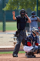 Home plate umpire Bailey Dutten asks for new baseballs during an Arizona League game between the AZL Indians Red and the AZL Indians Blue on July 7, 2019 at the Cleveland Indians Spring Training Complex in Goodyear, Arizona. The AZL Indians Blue defeated the AZL Indians Red 5-4. (Zachary Lucy/Four Seam Images)