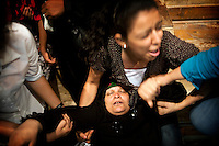 A Muslim woman, in trance, fainted in the arms of another woman.<br />