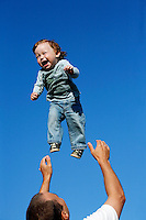 Andrei Balta throws his fifteen-month-old son Vanya in the air during a summer evening in Slavutych, Ukraine. Andrei and his wife Anna both work at the nearby Chernobyl Nuclear Power Plant, as do over 3,800 residents of Slavutych. <br /> ------------------- <br /> This photograph is part of Michael Forster Rothbart's After Chernobyl documentary photography project.<br /> © Michael Forster Rothbart 2007-2010.<br /> www.afterchernobyl.com<br /> www.mfrphoto.com <br /> 607-267-4893 o 607-432-5984<br /> 5 Draper St, Oneonta, NY 13820<br /> 86 Three Mile Pond Rd, Vassalboro, ME 04989<br /> info@mfrphoto.com<br /> Photo by: Michael Forster Rothbart<br /> Date: 7/2009    File#:  Canon 5D digital camera frame 72371<br /> ------------------- <br /> Original caption: .Andrei Balta throws his fifteen-month-old son Vanya in the air during a summer evening in Slavutych, Ukraine. Every evening, parents with babies and toddlers gather in the central square of Slavutych to socialize. Andrei and his wife Anna both work at the nearby Chernobyl Nuclear Power Plant, as do over 3,800 residents of Slavutych.