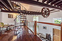 BNPS.co.uk (01202 558833)<br /> Pic: KnightFrank/BNPS<br /> <br /> Pictured: Mezzanine.<br /> <br /> An impressive family home built in an 'industrial scale' oast house with multiple circular rooms is on the market for £1.6m.<br /> <br /> The property is one half of a massive former six roundel oast house that has been expanded and renovated by the current owners.<br /> <br /> Estate agents Knight Frank say the roundels are far larger than normally seen in most oast houses, which means the property has quirky character while also being a practical family home.<br /> <br /> This six-bedroom house is in the picturesque Kent countryside, but just 1.5 miles from the village of Hadlow and ten minutes' drive from the bigger town of Tonbridge.