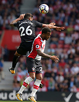 (L-R) Kyle Naughton of Swansea City battles for a header against Ryan Bertrand of Southampton during the Premier League match between Southampton and Swansea City at the St Mary's Stadium, Southampton, England, UK. Saturday 12 August 2017