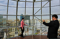 Tourists take photos in the dome of the  most famous building in Astana the Bayterek in Astana, the capitol of Kazakstan.<br /> <br /> PHOTO BY RICHARD JONES/SINOPIX