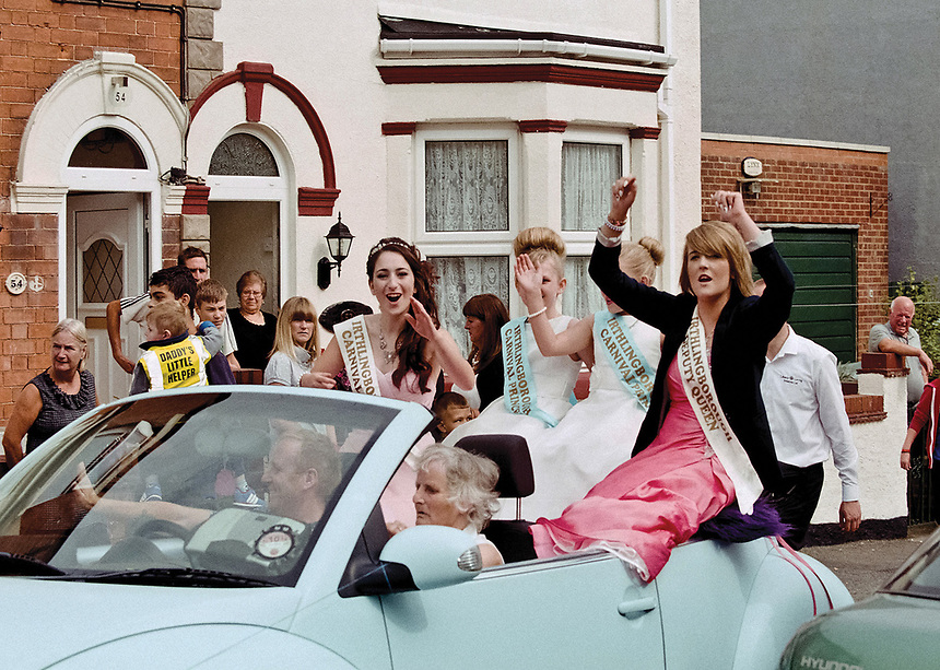 """Queen of Irthlingborough, Frankie Gent acknowledges her well-wishers as she is driven through the town accompanied by Deputy Queen Jessica Parker, Princess Mira and Princess Tia.<br /> <br /> """"Fully qualified beauty therapist."""""""