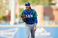 Lexington Legends starting pitcher Henry Owens (18) looks to his catcher for the sign against the High Point Rockers at Truist Point on June 16, 2021, in High Point, North Carolina. The Legends defeated the Rockers 2-1. (Brian Westerholt/Four Seam Images)