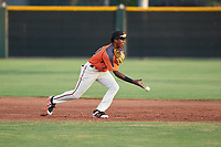 AZL Giants Orange shortstop Marco Luciano (10) flips a ball to second base during an Arizona League game against the AZL Mariners on July 18, 2019 at the Giants Baseball Complex in Scottsdale, Arizona. The AZL Giants Orange defeated the AZL Mariners 7-4. (Zachary Lucy/Four Seam Images)