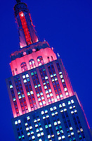 New York City. Empire State Building illuminated at night with Christmas lighting