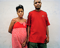 Madelena, who arrived in the UK from Angola in August 2007, stands with her boyfriend Sami. She is unable to work and survives only on the kindness of friends. Her father was killed by the Angolan government because of his political activities and she was arrested, detained and badly beaten. While in detention her mother also went missing and she still does not know whether she is alive. After her asylum claim was refused, and in terror of being forcibly returned to Angola, a friend agreed to let her share a room with her. Sometimes she survives an entire week with no money at all, depending on friends, charities and churches to give her food. At the end of last year she gave birth to Grace with her boyfriend Sami, who is also an asylum seeker from Angola. Madelena is one of an estimated 300,000 rejected asylum seekers living in the UK.