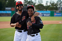 Batavia Muckdogs Jeremy Ovalle (19) and Samuel Castro (3) after a walk off victory during a NY-Penn League game against the Auburn Doubledays on June 19, 2019 at Dwyer Stadium in Batavia, New York.  Batavia defeated Auburn 5-4 in eleven innings in the completion of a game originally started on June 15th that was postponed due to inclement weather.  (Mike Janes/Four Seam Images)