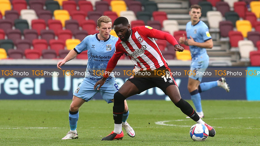 Josh DaSilva of Brentford shields the ball from Coventry City's Jamie Allen during Brentford vs Coventry City, Sky Bet EFL Championship Football at the Brentford Community Stadium on 17th October 2020
