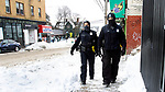 WATERBURY CT. - 18 December 2020-121820SV02-From left, Officers Tammy Adler and Robert Torres do a walking patrol on Willow Street in Waterbury Friday.<br /> Steven Valenti Republican-American