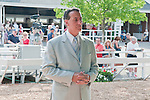 Justin Sallusto, trainer of Teaks North, winner of the 58th Grade I United Nations Stakes in the Monmouth paddock.