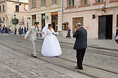 A photographer takes wedding pictures outside the Town Hall in central Lviv, a favourite spot for newly married couples.