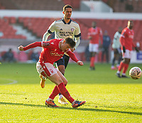 9th January 2021; City Ground, Nottinghamshire, Midlands, England; English FA Cup Football, Nottingham Forest versus Cardiff City; Joe Lolley of Nottingham Forest clears the ball forward in front of Robert Glatzel of Cardiff City