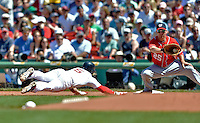 10 June 2012: Washington Nationals first baseman Adam LaRoche makes a play as Nick Punto dives back to the bag during action against the Boston Red Sox at Fenway Park in Boston, MA. The Nationals defeated the Red Sox 4-3 to sweep their 3-game interleague series. Mandatory Credit: Ed Wolfstein Photo