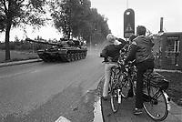 """- NATO exercises in the Netherlands, British tank """"Chieftain"""" cross a village (October 1983)....- esercitazioni NATO in Olanda, carro armato britannico """"Chieftain"""" attraversa un villaggio (ottobre 1983)"""