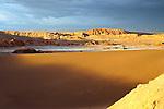 Thunderstorm developing over sand dune in Valle De La Luna in the Atacama Desert near San Pedro de Atacama, Chile.